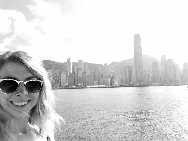 Taking a selfie in front of Hong Kong skyline
